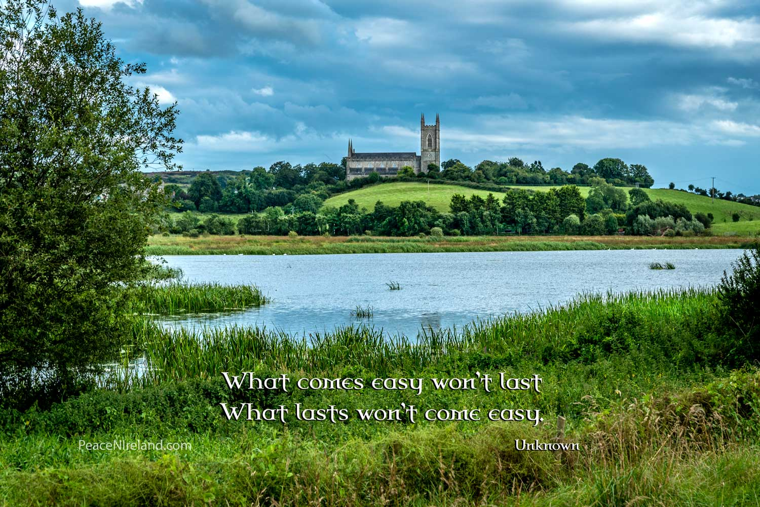 The River Quoile from Inch Abbey, Downpatrick, with a view of  the Mound of Down Cathedral where St Patrick's remains are buried.